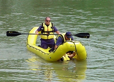 Photo of firefighters in inflatable rescue craft