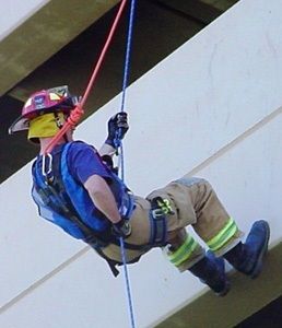 photo of firefighter rappelling