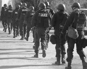 Photo of SWAT Team and Medics walking