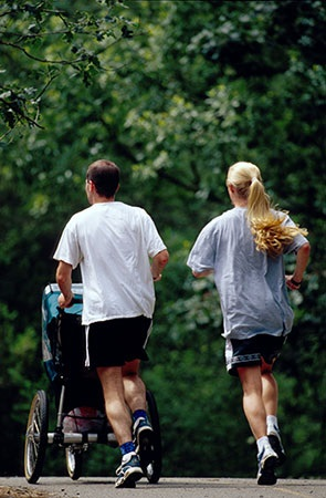 Couple Running with Child