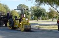 photo of a steamroller making street repairs