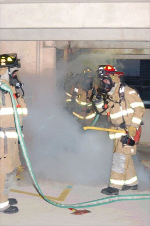 photo of firefighters putting out fire