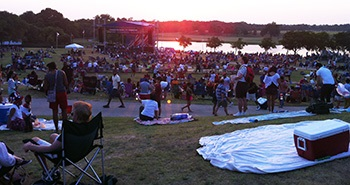 Photo of crowd settling in at sunset