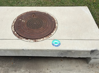 Storm Drain Marker next to storm drain